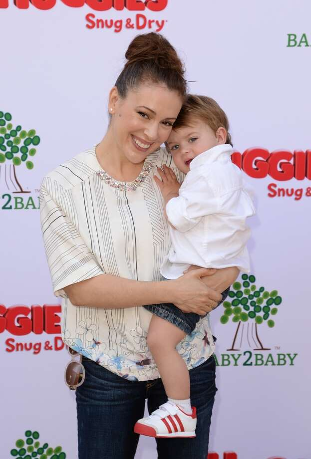 LOS ANGELES, CA - APRIL 27:  Actress Alyssa Milano and her son Milo attend the Huggies Snug & Dry and Baby2Baby Mother's Day Garden Party held on April 27, 2013 in Los Angeles, California.  (Photo by Jason Merritt/Getty Images for Baby2Baby)