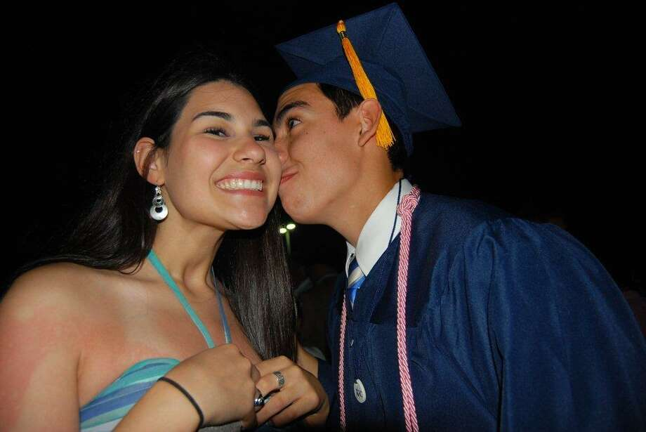 Now: In 2012, Kevin Becerra graduated from Central Catholic High School. He kisses his sister Anna, re-creating a scene from 16 years earlier when she was 2 and he was 3. Kevin is now a freshman in the honors program at Texas Tech while Anna is a senior at Incarnate Word High School. Photo: Becerra, Reader Submission