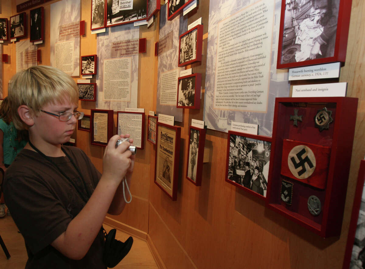 James Rheinlaender,11, takes a picture while looking at exhibits at the Holocaust Memorial Museum of San Antonio Thursday May 27, 2010. JOHN DAVENPORT/jdavenport@express-news.net