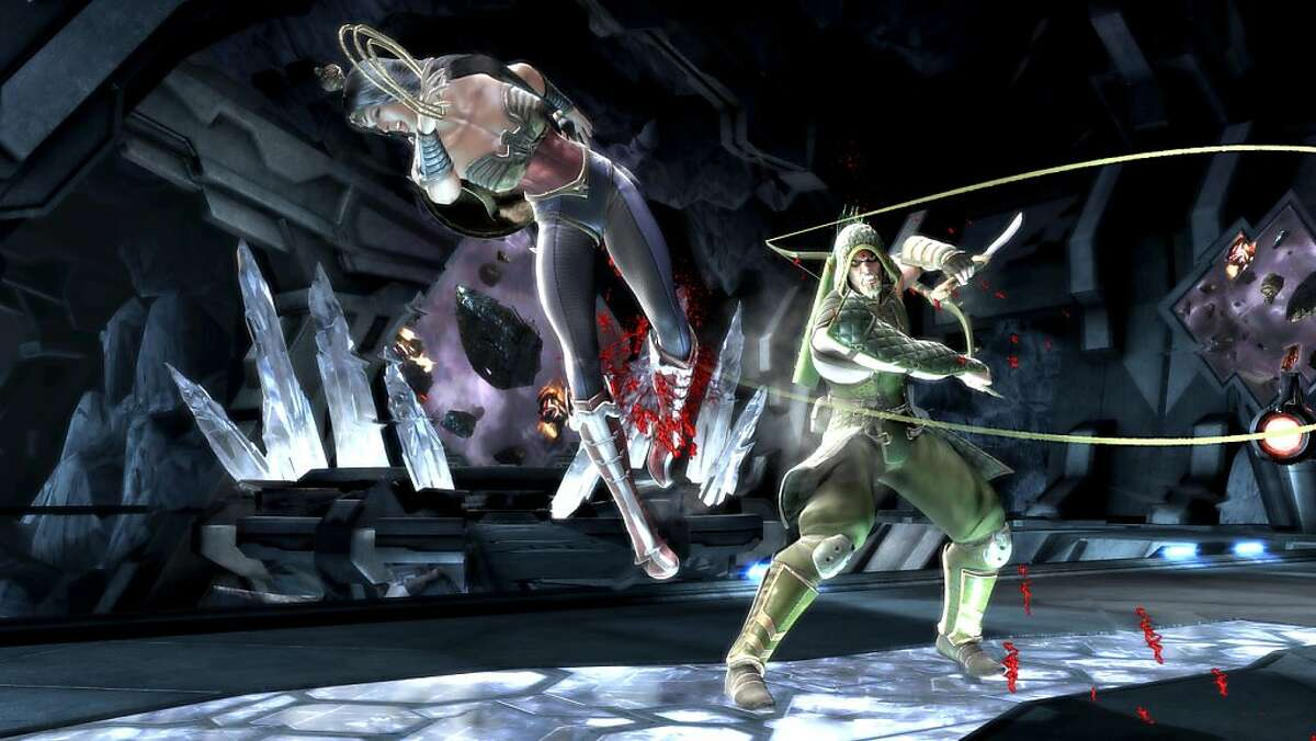 Wonder Woman and Green Arrow fight in the Batcave in