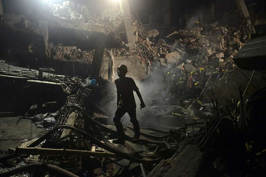A worker leaves the site where a garment factory building collapsed near Dhaka, Bangladesh Monday, April 29, 2013. Rescue workers in Bangladesh gave up hopes of finding any more survivors in the remains of a building that collapsed five days ago, and began using heavy machinery on Monday to dislodge the rubble and look for bodies - mostly of workers in garment factories there. At least 381 people were killed when the illegally constructed, 8-story Rana Plaza collapsed in a heap on Wednesday morning along with thousands of workers in the five garment factories in the building. (AP Photo/Ismail Ferdous) Photo: Ismail Ferdous, Associated Press