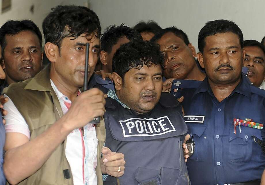 Mohammed Sohel Rana, center, the owner of a building that collapsed last week, killing at least 382 people, is brought to be produced at a court in Dhaka, Bangladesh, Monday, April 29, 2013. A Bangladesh court on Monday gave police 15 days to interrogate Rana, as rescuers used heavy machinery to cut through the destroyed structure after giving up hopes of finding any more survivors. (AP Photo) Photo: Associated Press