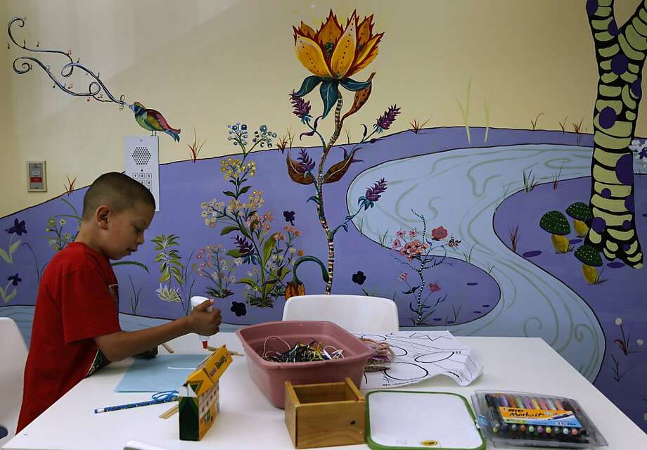Murals grace the walls of the outpatient infusion center at Children's Hospital Oakland where Javier Landeros Jr. is treated. Photo: Paul Chinn, The Chronicle