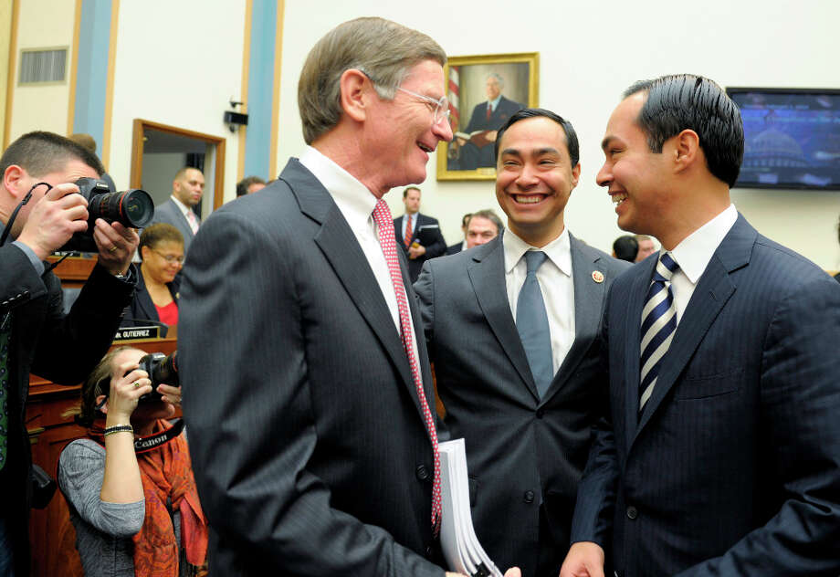 San Antonio Texas Mayor Julian Castro, right, and his brother Rep. Joaquin Castro, D-Texas, center, talk with Rep. Lamar Smith, R-Texas, all from San Antonio, before the beginning of the House Judiciary Committee hearing on America's Immigration System on Capitol Hill in Washington, Tuesday, Feb. 5, 2013. Mayor Castro was one of the witnesses.(AP Photo/Susan Walsh) Photo: Susan Walsh, Associated Press / AP