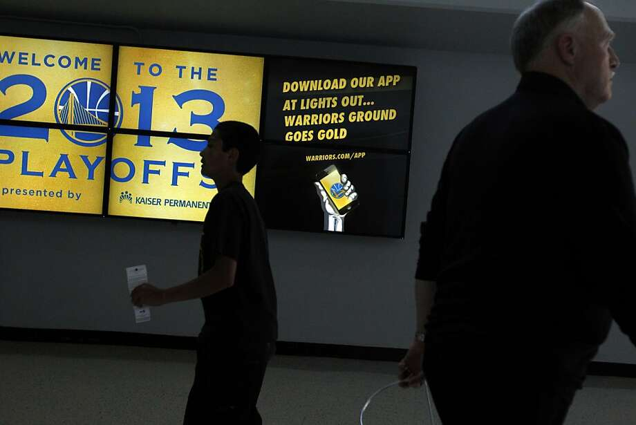 New digital signage shows the latest updates and offers including the new Warriors App before the game against the Denver Nuggets on Sunday, April 28, 2013, at Oracle Arena in Oakland, Calif.  Photo: Carlos Avila Gonzalez, The Chronicle