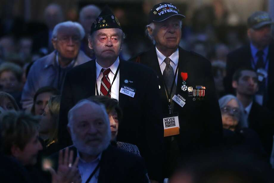 World War II veterans stand as they are recognized for their service at the 20th anniversary of the United States Holocaust Memorial Museum in Washington, Monday, April 29, 2013. (AP Photo/Charles Dharapak) Photo: Charles Dharapak, Associated Press
