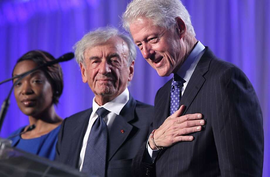 Former President Bill Clinton (right) appears at the Holocaust Museum event with Nobel Peace Prize laureate Elie Wiesel and the museum's Rebecca Dupas. Photo: Alex Wong, Getty Images