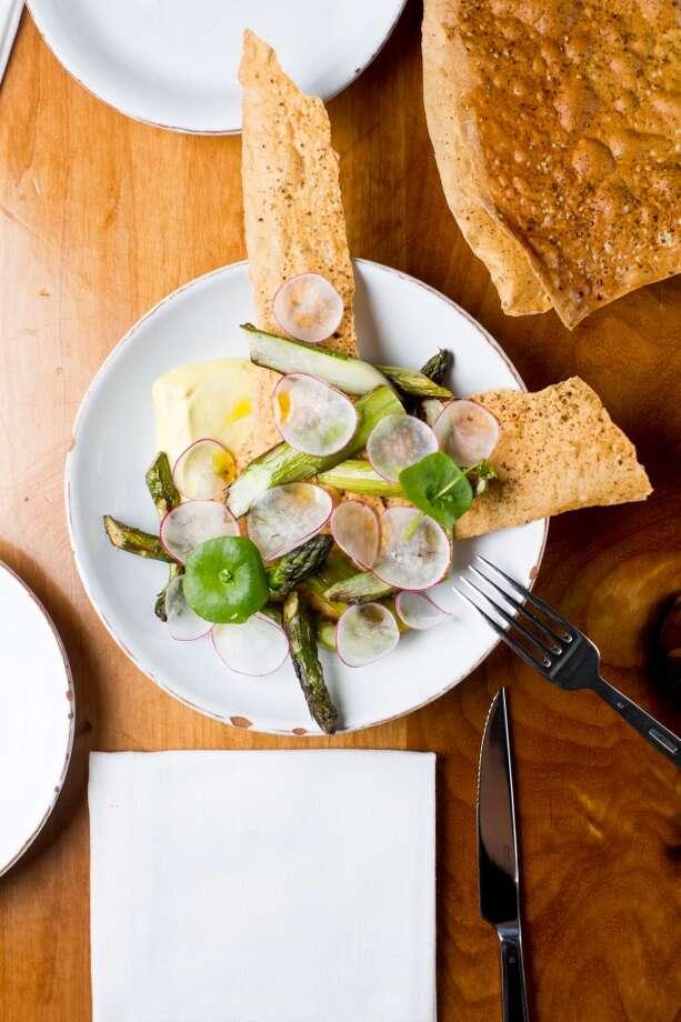 Glen Ellen Star: Wood roasted asparagus, carta musica, shaved radish, hen egg emulsion.