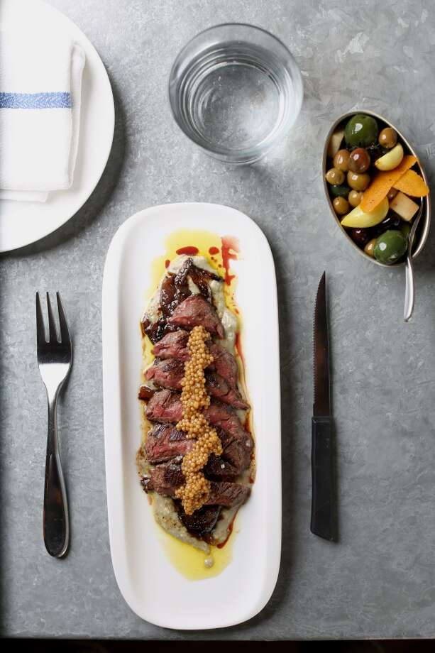 Bravas Bar de Tapas in Healdsburg: Skirt Steak, Red Onion Marmalade, Valderon Cheese and Marinated Olives, Pickled Garlic
