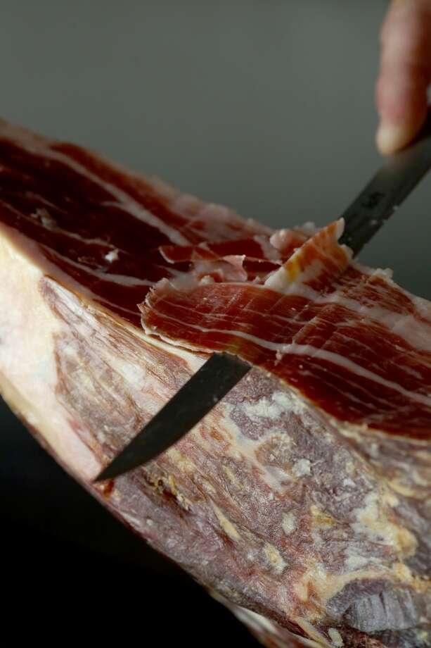 Bravas Bar de Tapas: Mark Stark slices jamon serrano