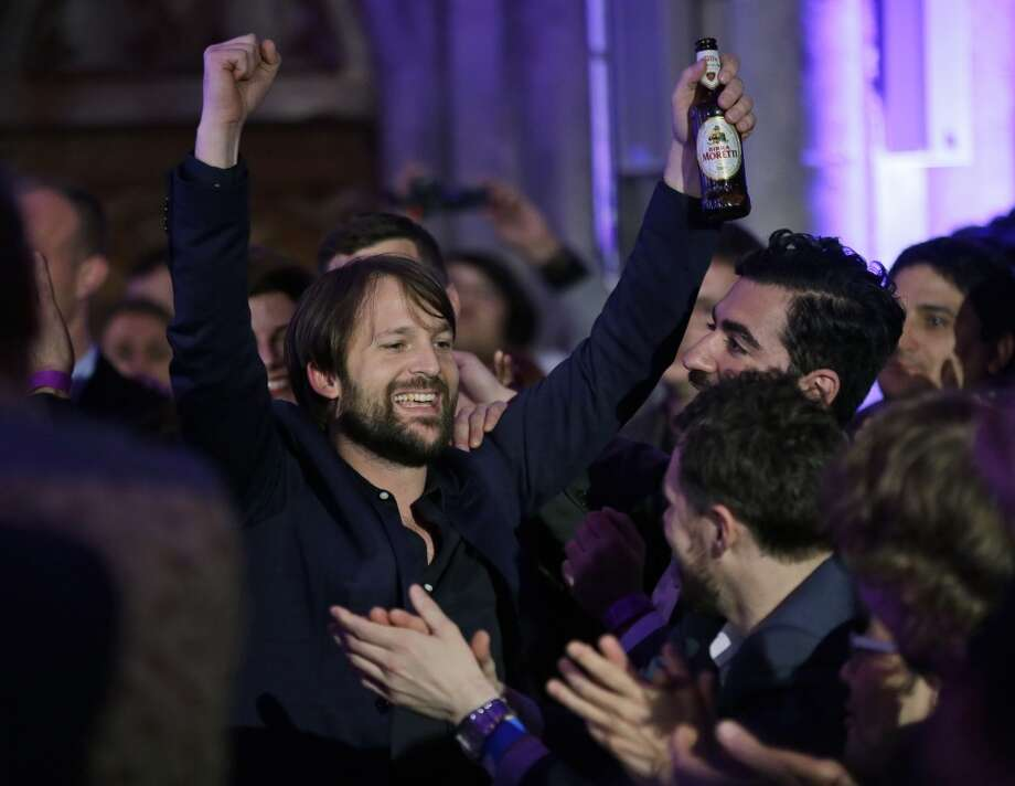 Danish chef Rene Redzepi celebrates after his restaurant Noma in Copenhagen, Denmark won the second place.