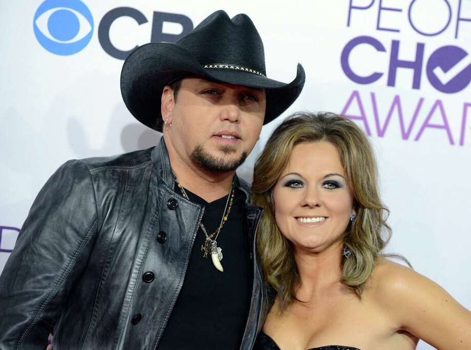 FILE - This Jan. 9, 2013 file photo shows Jason Aldean, left, and his wife Jessica at the People's Choice Awards at the Nokia Theatre in Los Angeles. Court papers filed April 26, show Aldean has filed for divorce from his wife Jessica Ussery.  (Photo by Jordan Strauss/Invision/AP, file) Photo: Jordan Strauss