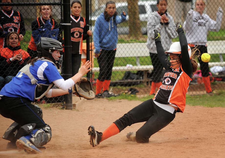 Stamford's Nikki Pease slides safely into home ahead of the throw to Ludlowe catcher Katie DeCarlo on a suicide squeeze bunt play in the sixth inning of their girls softball game at Ludlowe High School in Fairfield, Conn. on Monday, April 29, 2013. Stamford won the game 13-10. Photo: Brian A. Pounds / Connecticut Post