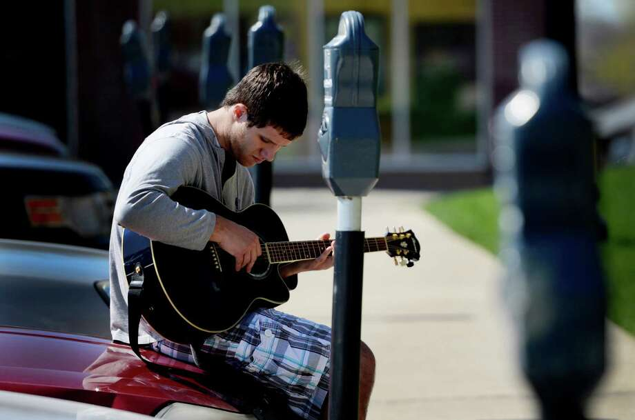 RPI sophomore Brian Corbin enjoys the beautiful day and some home made music Wednesday April 24, 2013, as he tunes up on campus in Troy, N.Y.   (Skip Dickstein/Times Union) Photo: SKIP DICKSTEIN