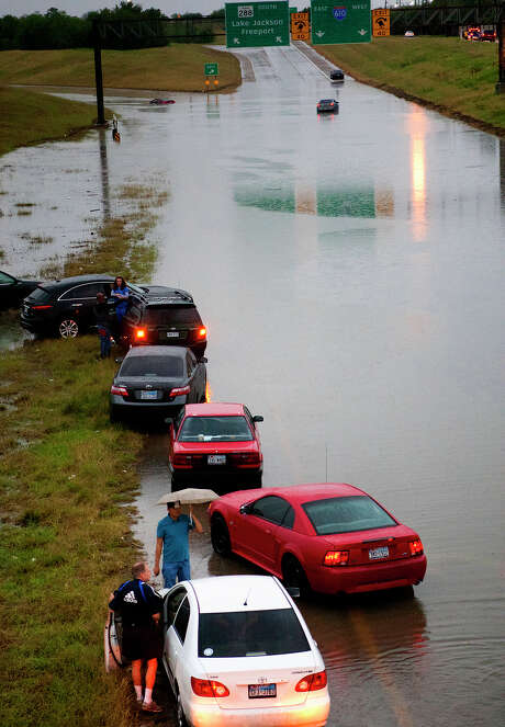 Saturday's surprise storm caused big headaches for Houston-area drivers,  including these who were stranded along a flooded 288 just north of 610. Photo: Cody Duty, Staff / © 2013 Houston Chronicle