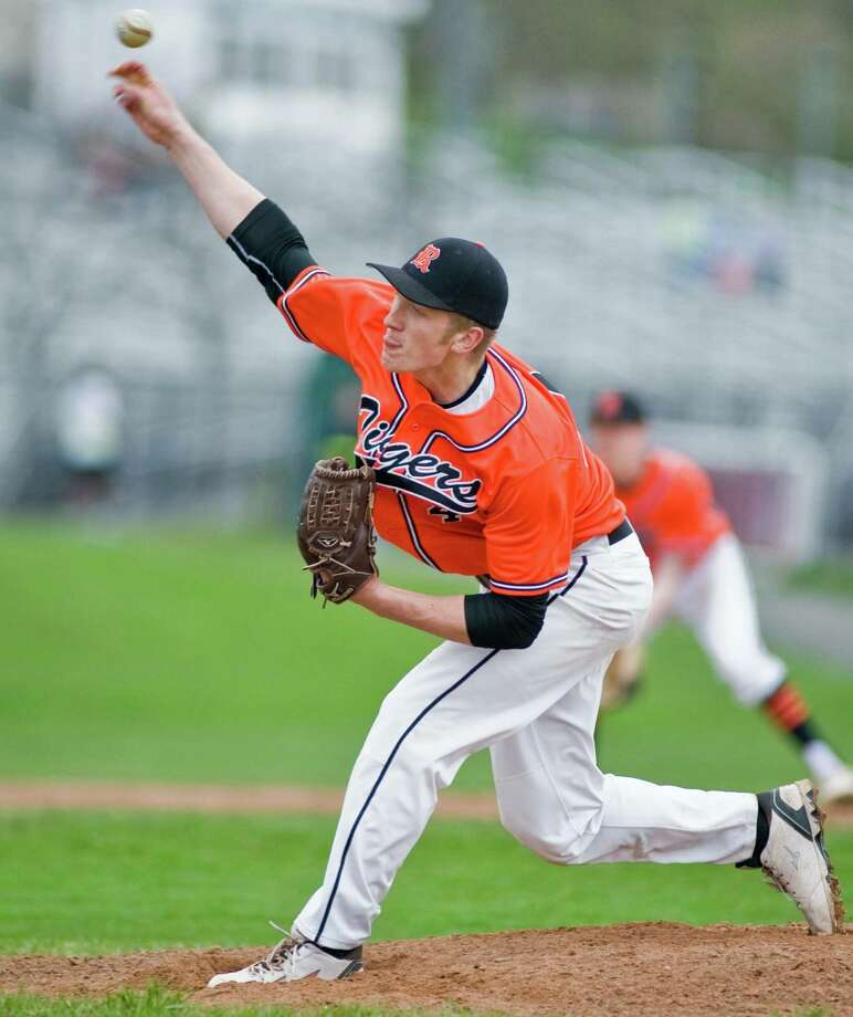 Ridgefield High School pitcher Devin Martin fires the ball during a game against Danbury High School, played at Danbury. Monday, April  29, 2013 Photo: Scott Mullin / The News-Times Freelance