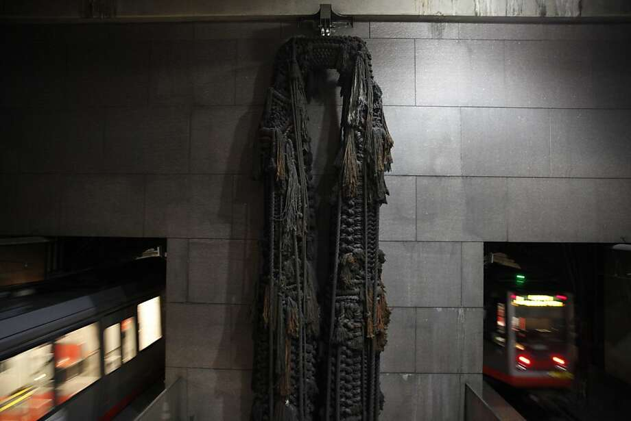 "A macrame sculpture titled ""Legs"" by Barbara Shawcroft hangs at the east end of the Embarcadero BART station on Friday, April 26, 2013 in San Francisco, Calif. Photo: Lea Suzuki, The Chronicle"