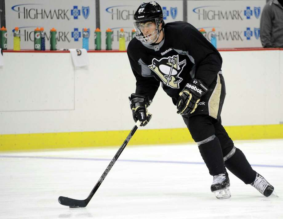The Penguins' Sidney Crosby practices with his team Monday, but he hasn't played a game in a month because of a broken jaw. Photo: Chaz Palla, MBO / Pittsburgh Tribune-Review