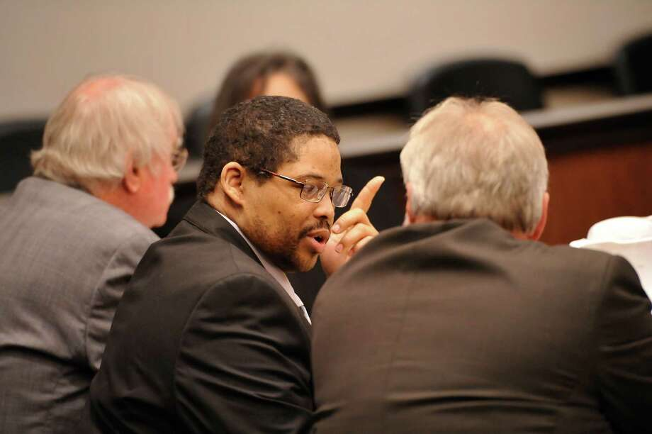 Bartholomew Granger, center, is flanked by his attorneys James Makin, right, and Sonny Cribbs before the start of his trial in Galveston on April 22. Photo: Dave Ryan, MBO / The Beaumont Enterprise