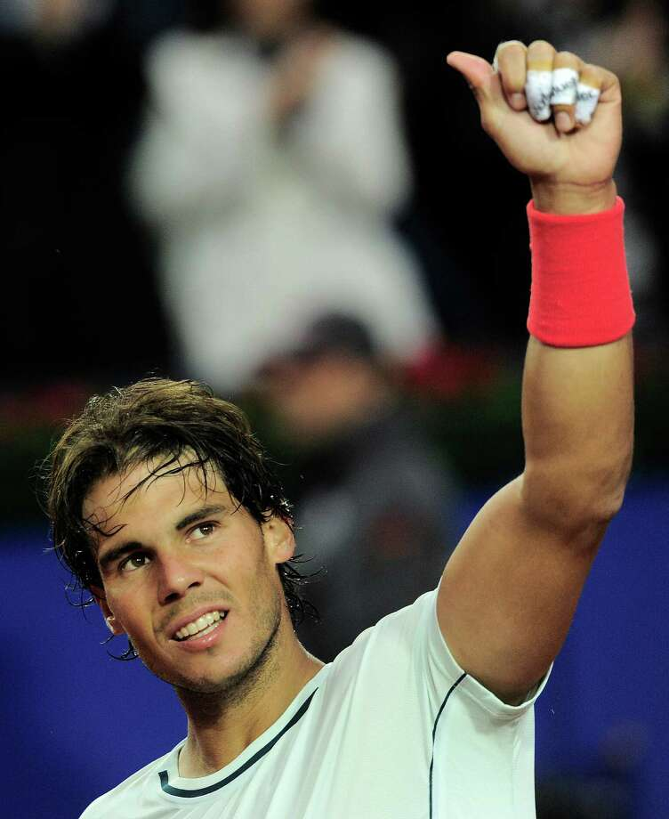 Rafael Nadal of Spain celebrates after his victory over Milos Raonic during the Barcelona semifinal open tennis in Barcelona, Spain, Saturday, April 27, 2013. Nadal won 6-4, 6-0. (AP Photo/Manu Fernandez) Photo: Manu Fernandez