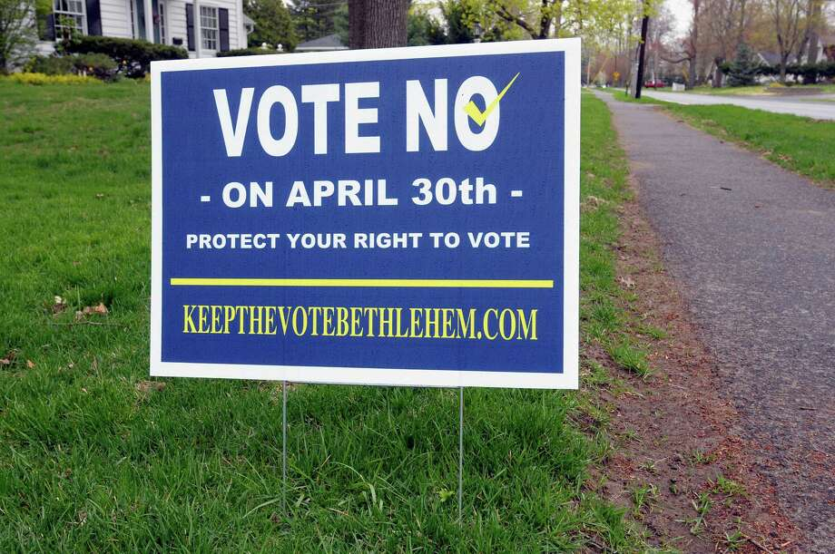 A view of a sign outside a home on Kenwood Ave. on Monday, April 29, 2013 in Bethlehem, NY.  The vote no and vote yes signs have to do with a controversy over highway superintendent vote in Bethlehem.   (Paul Buckowski / Times Union) Photo: Paul Buckowski