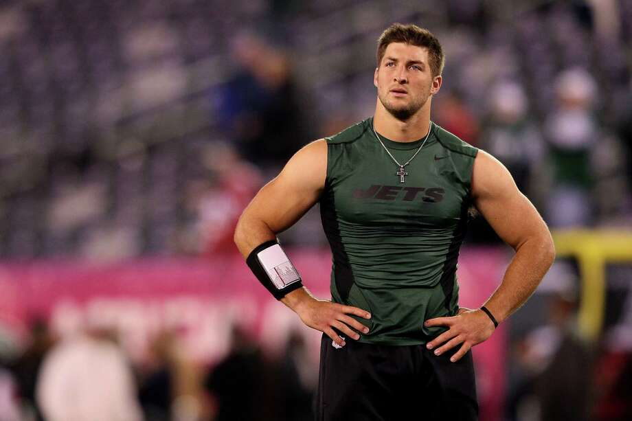 FILE - APRIL 29, 2013: It was announced that the New York Jets have decided to cut quarterback Tim Tebow April 29, 2013.  EAST RUTHERFORD, NJ - OCTOBER 08:  Tim Tebow #15 of the New York Jets looks on as he warms up against the Houston Texans at MetLife Stadium on October 8, 2012 in East Rutherford, New Jersey.  (Photo by Alex Trautwig/Getty Images) Photo: Alex Trautwig