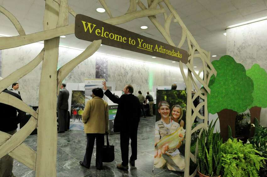 Visitors make their way into an area of exhibits during