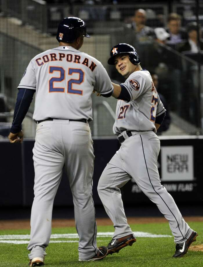 April 29: Astros 9, Yankees 1 Jose Altuve and Carlos Corporan celebrate after scoring runs in the fourth inning.