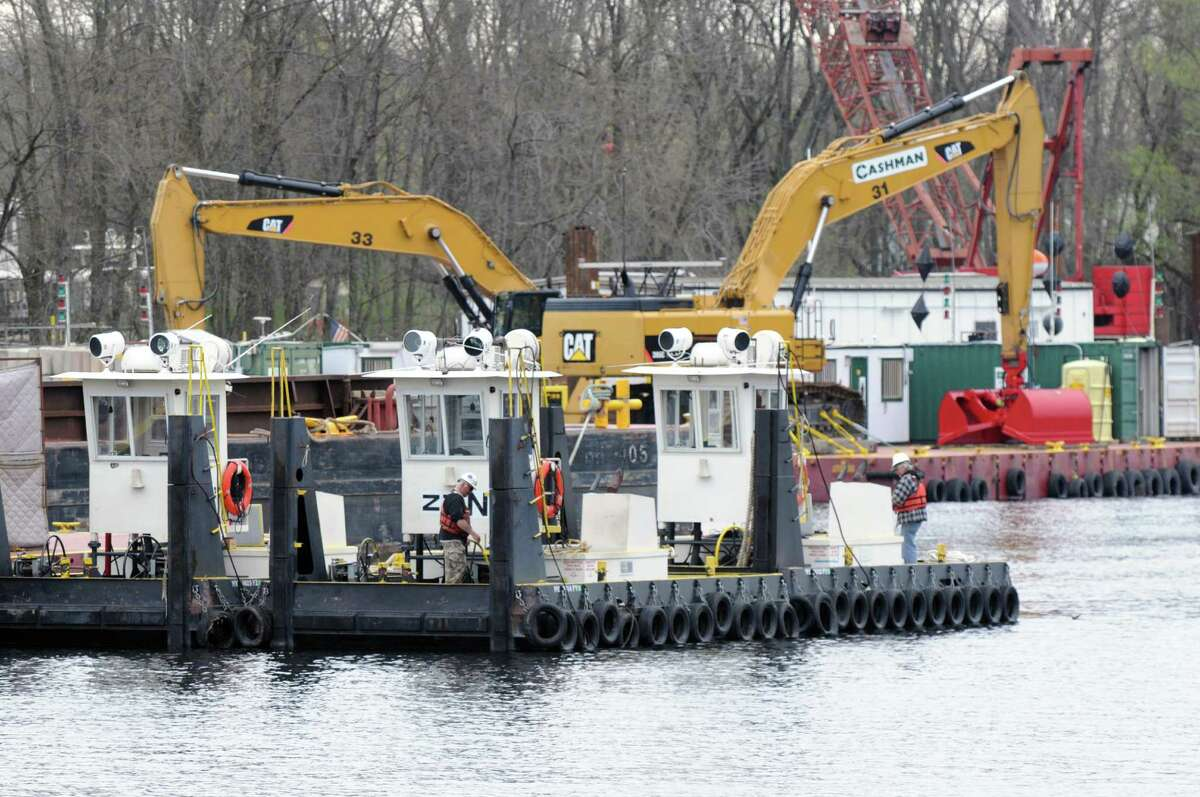Dredging equipment is moved into place Monday, April 29, 2013, on the Hudson River just south of Fort Edward, N.Y. Monday marked the start of the fourth season of dredging to remove sediment contaminated with polychlorinated biphenyls (PCBs) in the Upper Hudson River. (Will Waldron/Times Union)