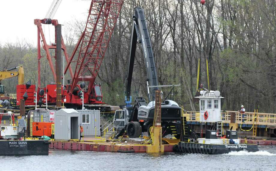 Dredging equipment is moved into place Monday, April 29, 2013, on the Hudson River just south of Fort Edward, N.Y. Monday marked the start of the fourth season of dredging to remove sediment contaminated with polychlorinated biphenyls (PCBs) in the Upper Hudson River.  (Will Waldron/Times Union) Photo: Will Waldron