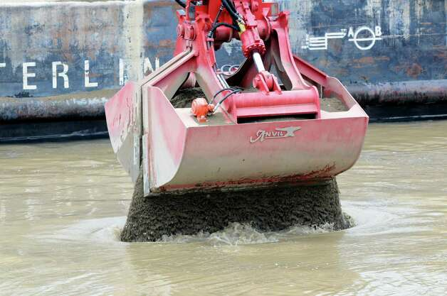 Backfill material is applied to a dredging site Monday, April 29, 2013, on the Hudson River just south of Fort Edward, N.Y. Monday marked the start of the fourth season of dredging to remove sediment contaminated with polychlorinated biphenyls (PCBs) in the Upper Hudson River. (Will Waldron/Times Union) Photo: Will Waldron
