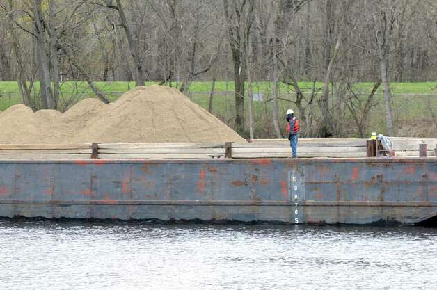 Material used to backfill dredging sites is moved into place Monday, April 29, 2013, on the Hudson River just south of Fort Edward, N.Y. Monday marked the start of the fourth season of dredging to remove sediment contaminated with polychlorinated biphenyls (PCBs) in the Upper Hudson River. (Will Waldron/Times Union) Photo: Will Waldron