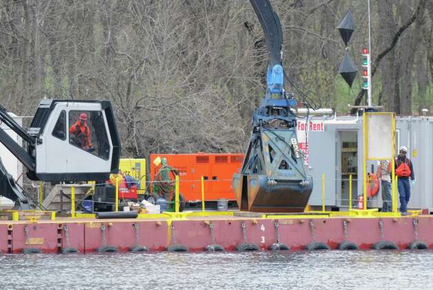 Dredging crews prepare their equipment Monday, April 29, 2013, on the Hudson River just south of Fort Edward, N.Y. Monday marked the start of the fourth season of dredging to remove sediment contaminated with polychlorinated biphenyls (PCBs) in the Upper Hudson River. (Will Waldron/Times Union) Photo: Will Waldron