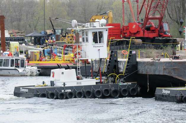 A barge containing backfill material is pushed down river to a dredging site Monday, April 29, 2013, on the Hudson River just south of Fort Edward, N.Y. Monday marked the start of the fourth season of dredging to remove sediment contaminated with polychlorinated biphenyls (PCBs) in the Upper Hudson River. (Will Waldron/Times Union) Photo: Will Waldron