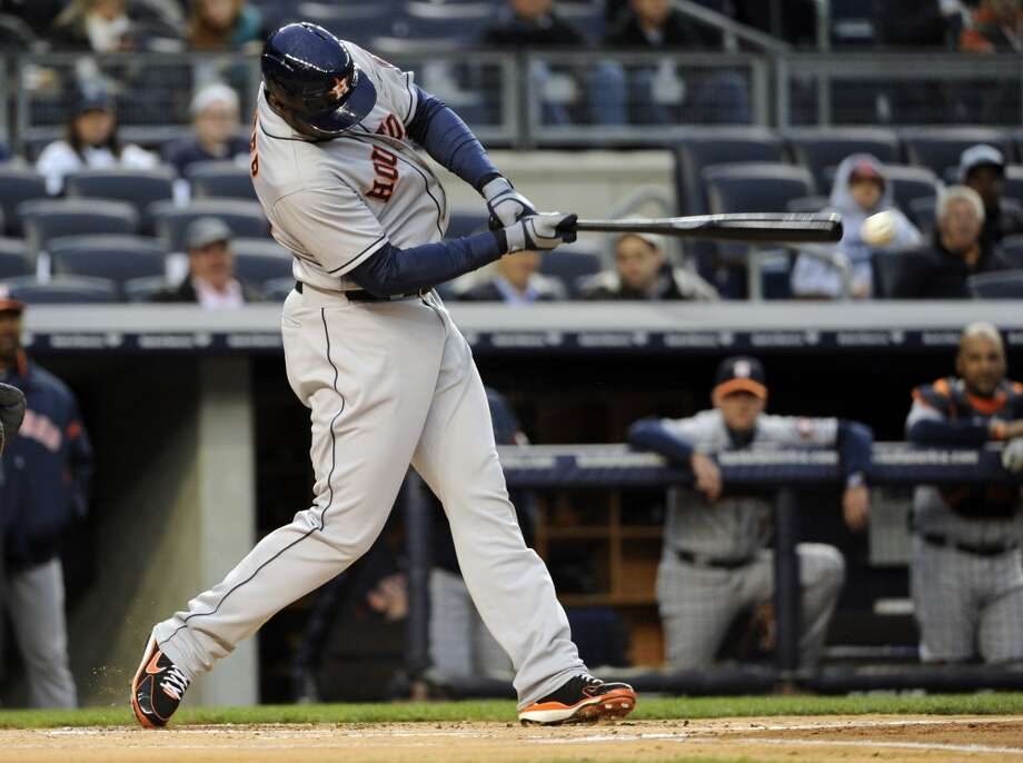 Chris Carter of the Astros connects on a single during the first inning.