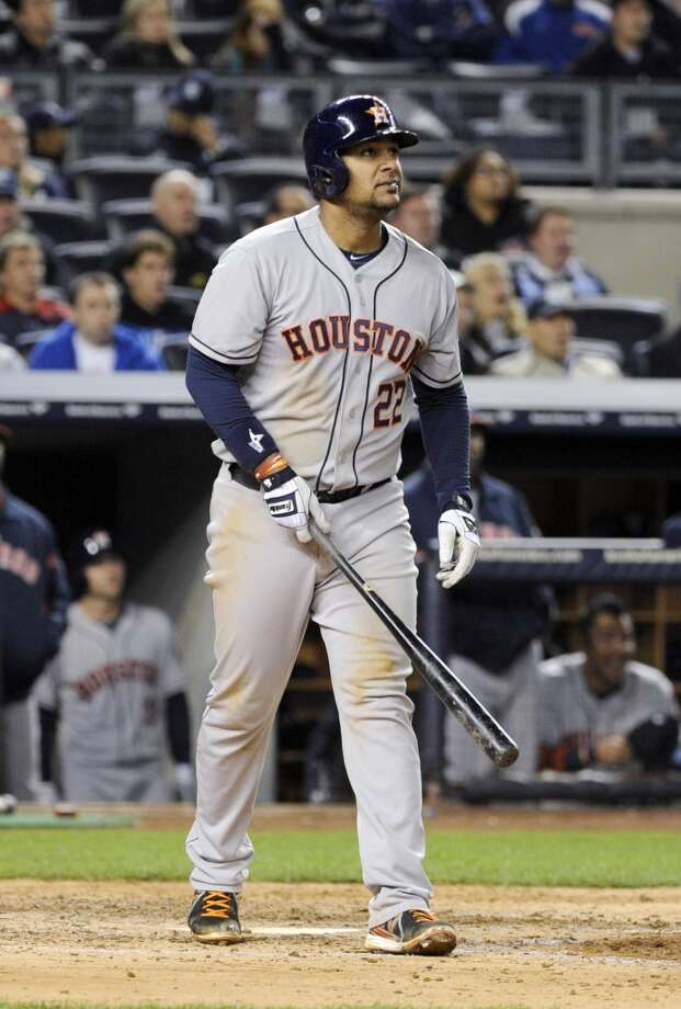 Carlos Corporan of the Astros starts to run the bases after hitting a home run during the fifth inning.