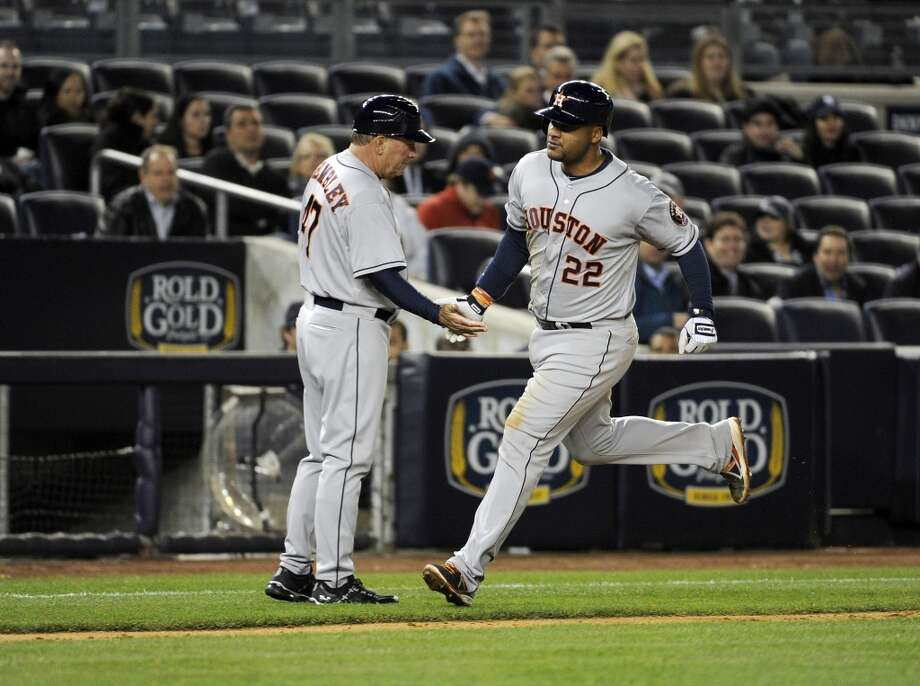 Astros third base coach Dave Trembley congratulates Carlos Corporan on his home run during the fifth inning. Photo: Bill Kostroun, Associated Press