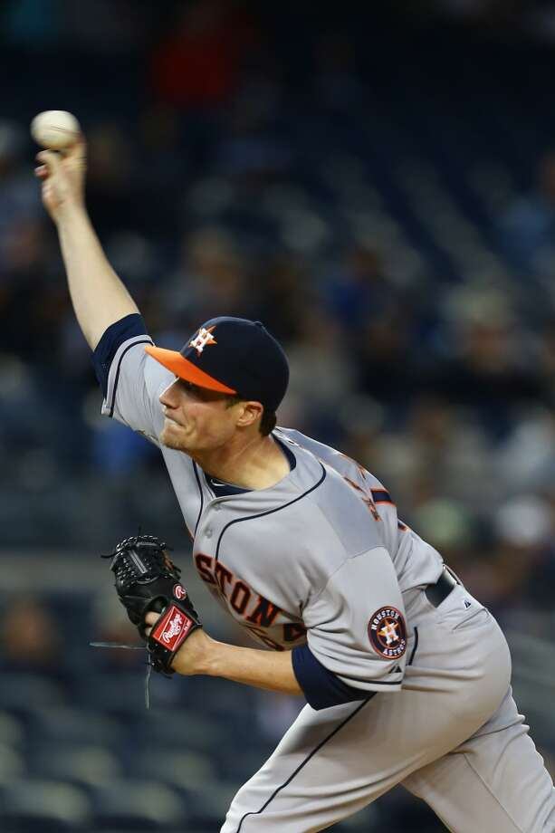 Lucas Harrell of the Astros delivers a pitch against the Yankees.