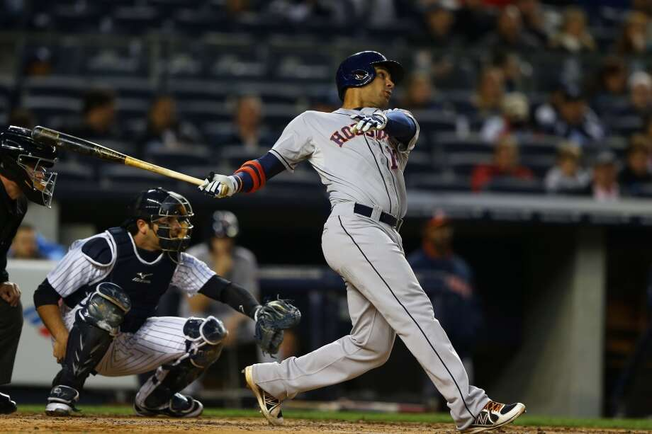 Carlos Pena of the Astros hits a triple against the Yankees. Photo: Al Bello, Getty Images