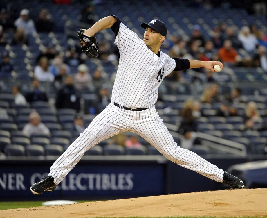 Andy Pettitte of the Yankees delivers a pitch against his former team, the Astros.