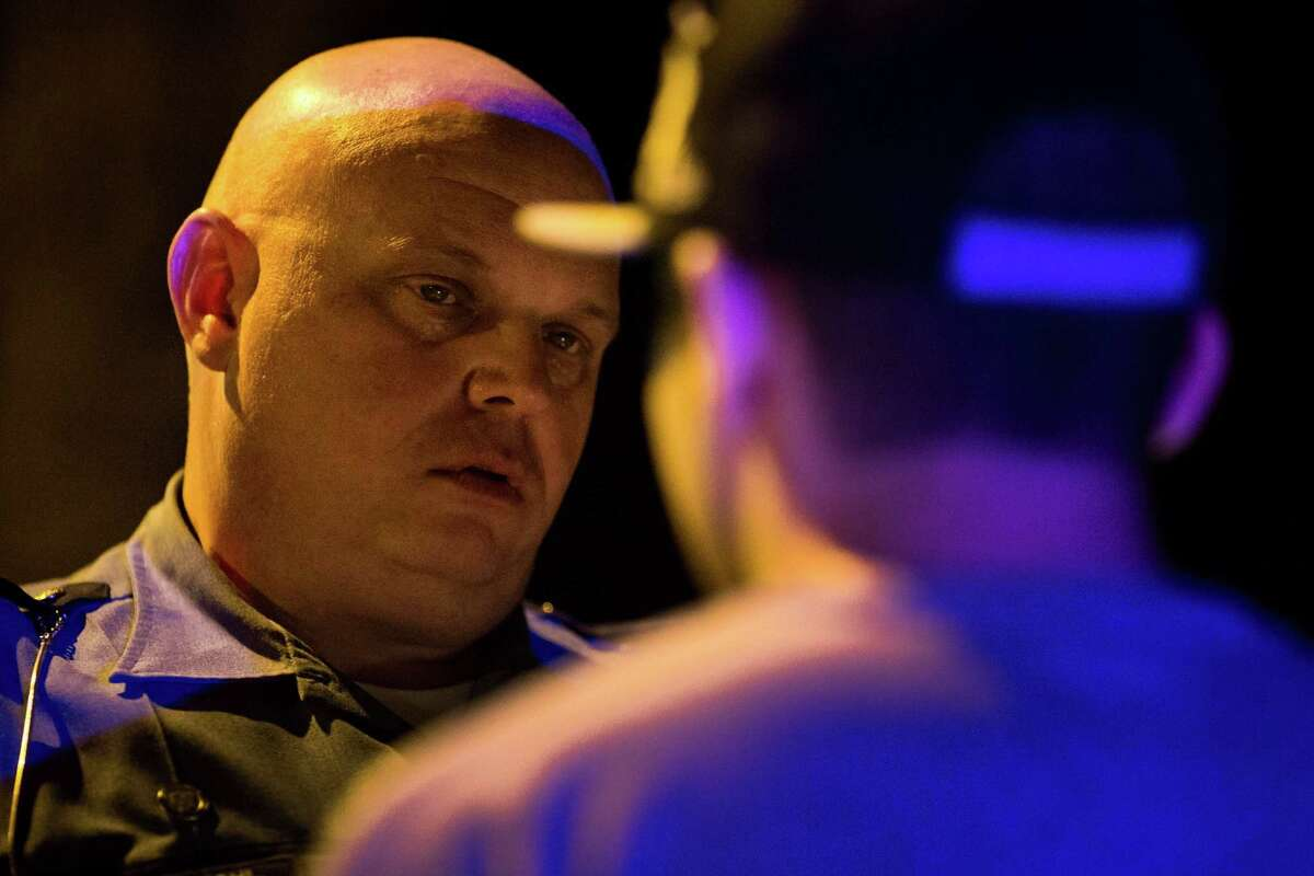Seattle Police officer and DUI specialist Eric Michl evaluates a man after an April 26 traffic stop. Michl, Seattle's top DUI cop who investigated the recent Wedgwood double-fatality case, said new laws aren't essential.