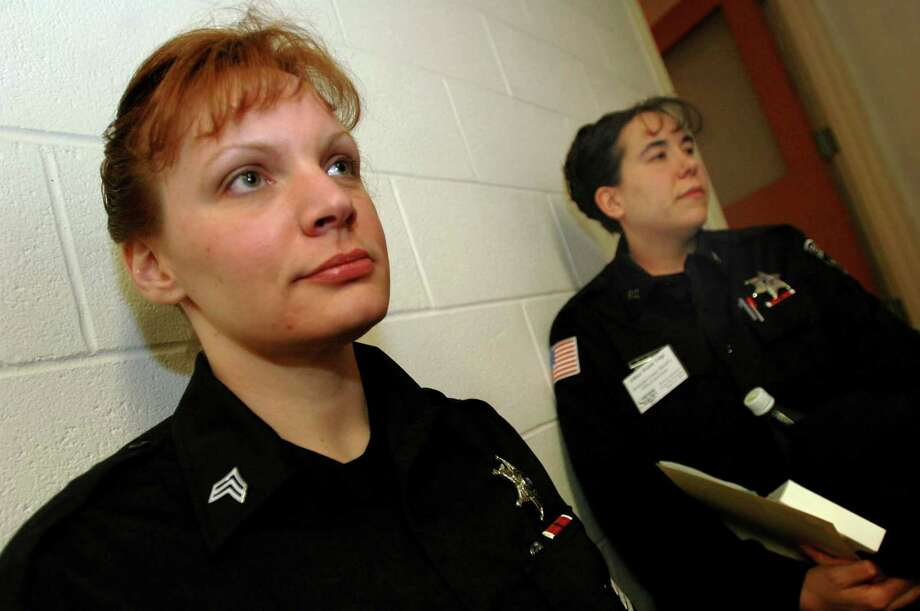 Lora Abbott Seabury, left, is shown in 2005, when she was Rensselaer County Sheriff's sergeant. At right is officer Wendy Eiega. (Times Union archive) Photo: LUANNE M. FERRIS / TIMES UNION