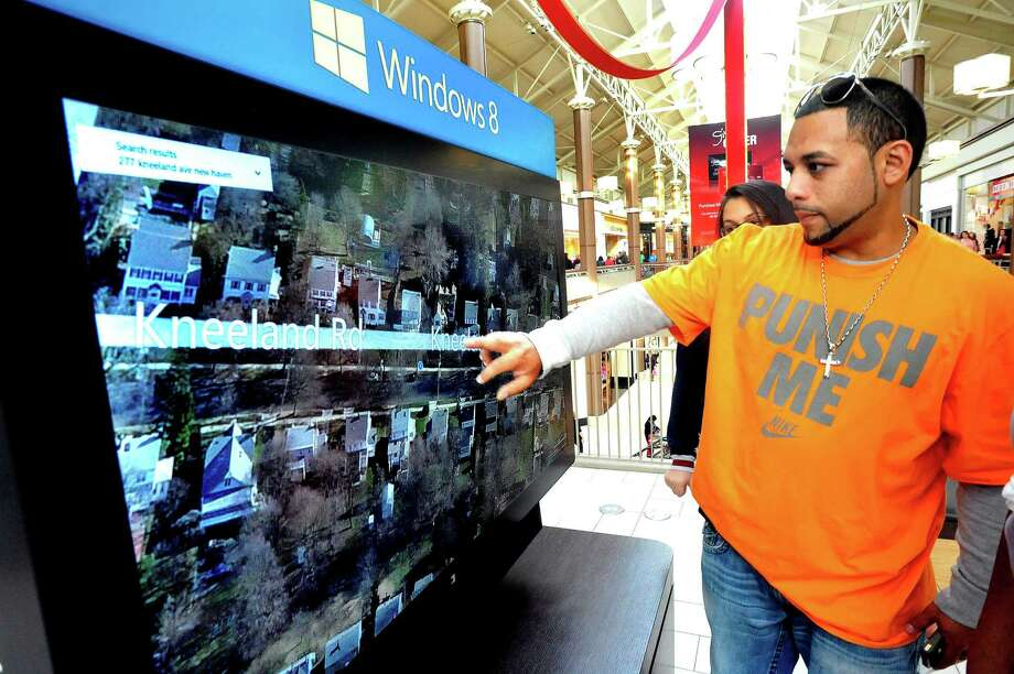 Danny Cruz looks for his house on Bing Maps, using Windows 8, on the other side of Microsoft's Dance Central 3 Xbox with Kinect at the Danbury Fair mall in this file photo. Photo: Michael Duffy / The News-Times