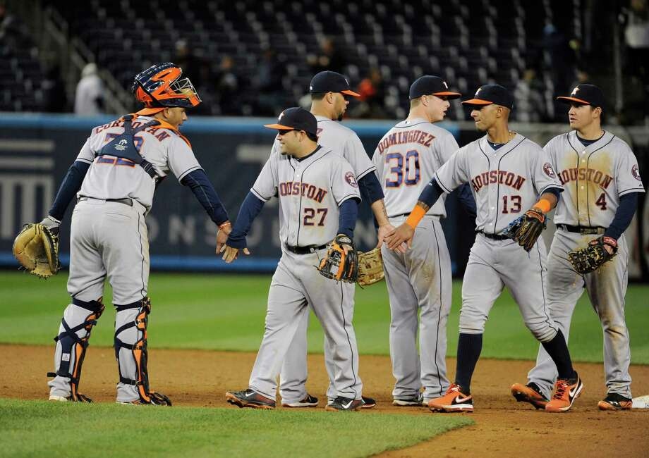 Carlos Corporan, left, had four hits and four RBIs in Monday's 9-1 win over the Yankees and also manned the receiving line for fellow Astros celebrants Jose Altuve (27), Matt Dominguez (30) and Ronny Cedeno (13). Photo: Bill Kostroun, FRE / FR51951 AP