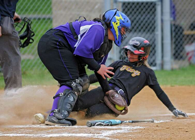 Catholic Central catcher Shelby Fenton tags Troy's Hunter Levesque out at the plate during a softbal