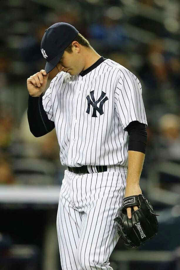 NEW YORK, NY - APRIL 29:  Adam Warren #43 of the New York Yankees reacts after giving up a home run to Carlos Corporan #22 of the Houston Astros in the fifth inning during their game on April 29, 2013 at Yankee Stadium in the Bronx borough of New York City  (Photo by Al Bello/Getty Images) Photo: Al Bello