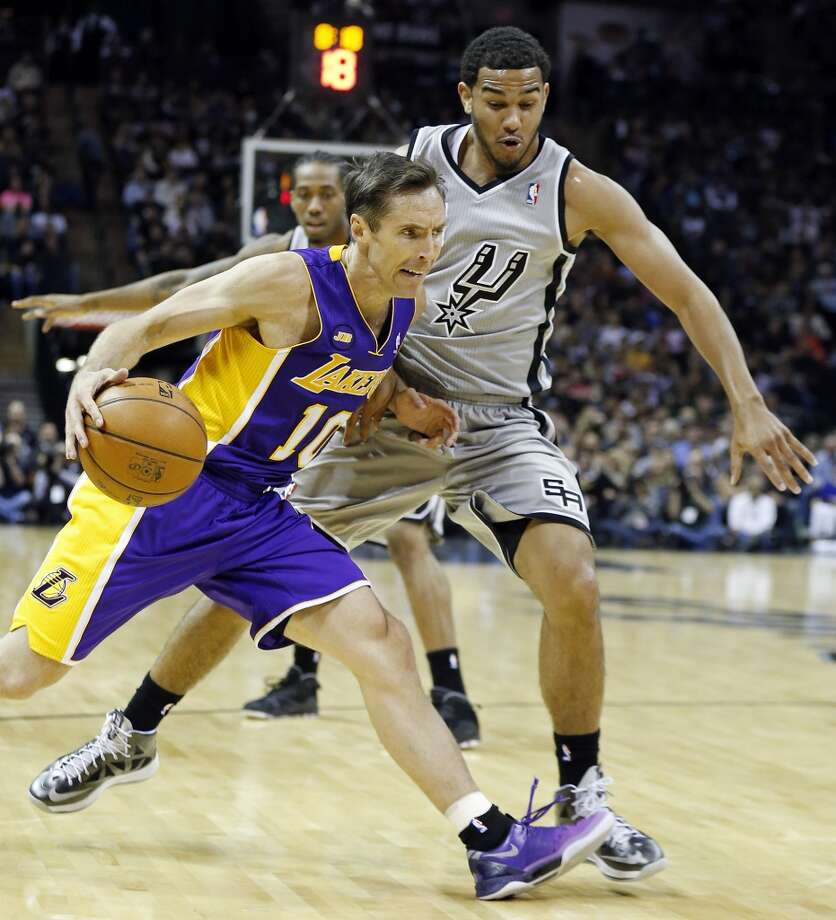 Los Angeles Lakers' Steve Nash looks for room around San Antonio Spurs' Cory Joseph during first half action of game 2 in the first round of the NBA Playoffs Wednesday April 24, 2013 at the AT&T Center.