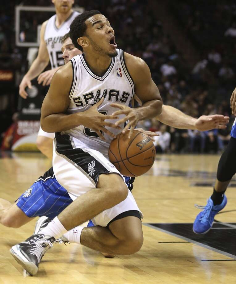 San Antonio Spurs' Cory Joseph is fouled by Orlando Magic's Beno Udrih during the second half at the AT&T Center, Wednesday, April 3, 3013. The Spurs won 98-84.