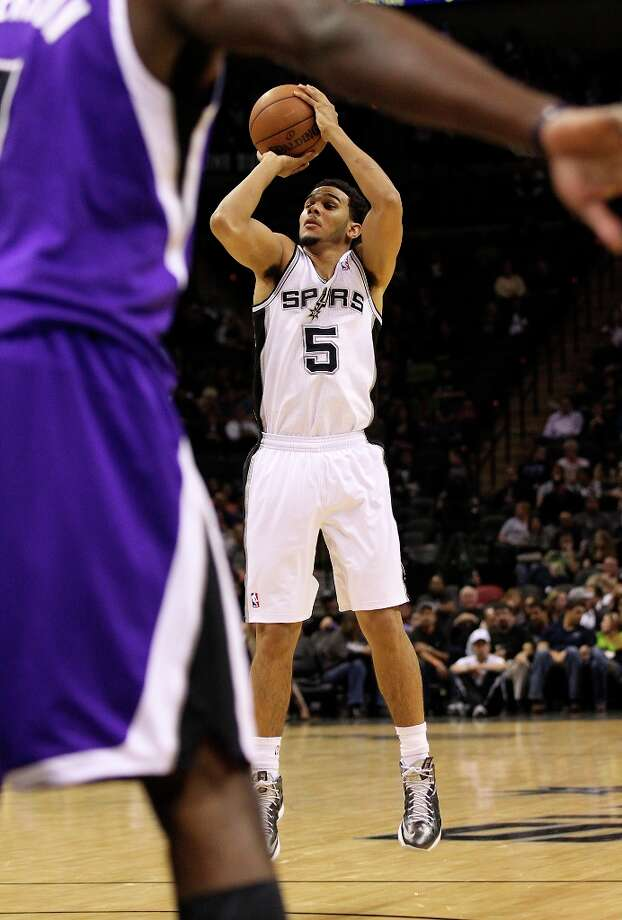 The Spurs' Cory Joseph (5) shoots at the top of the key against the Sacramento Kings in the second half at the AT&T Center on Friday, Mar. 1, 2013. Spurs defeated the Kings, 130-102. Photo: Kin Man Hui, San Antonio Express-News / © 2012 San Antonio Express-News