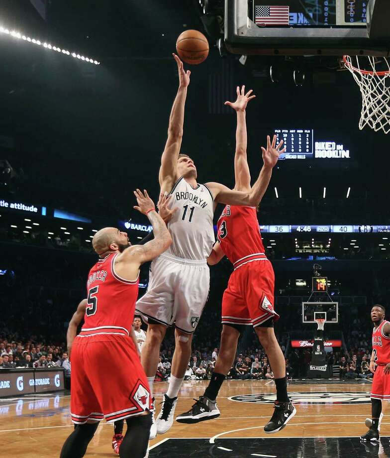 NEW YORK, NY - APRIL 29:  Brook Lopez #11 of the Brooklyn Nets led all scores with 28 against the Chicago Bulls during Game Five of the Eastern Conference Quarterfinals of the 2013 NBA Playoffs at the  Barclays Center on April 29, 2013 in New York City. The Nets defeated the Bulls 110-91. NOTE TO USER: User expressly acknowledges and agrees that, by downloading and or using this photograph, User is consenting to the terms and conditions of the Getty Images License Agreement.  (Photo by Bruce Bennett/Getty Images) Photo: Bruce Bennett